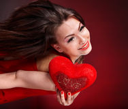 Girl with heart  in red flying. Valentines day. Stock Image