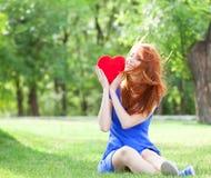 Girl with heart Stock Photos
