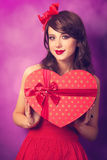 Girl with heart shape gift Stock Image