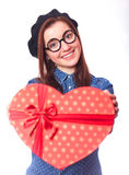 Girl with heart shape gift. Stock Photography