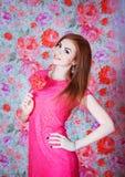 Girl with heart shape lollipop Stock Photo