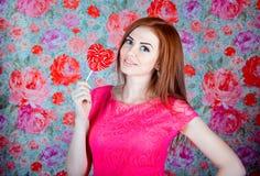 Girl with heart shape lollipop Stock Photography