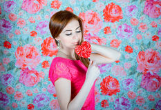 Girl with heart shape lollipop Royalty Free Stock Photography