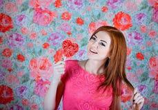 Girl with heart shape lollipop Stock Image