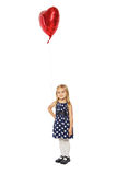 Girl with a heart-shaped balloon Stock Image