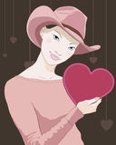 Girl with heart shaped card in hand Royalty Free Stock Image