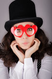 Girl with Heart-Shaped Glasses and Top Hat Royalty Free Stock Images