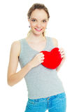 Girl with a heart-shaped pillow Royalty Free Stock Photography
