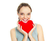 Girl with a heart-shaped pillow Royalty Free Stock Images