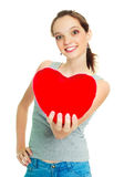 Girl with a heart-shaped pillow Royalty Free Stock Photos