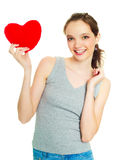Girl with a heart-shaped pillow Royalty Free Stock Photo