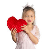 Girl with Heart-Shaped Pillow Stock Photos