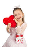 Girl with Heart-Shaped Pillow Royalty Free Stock Images
