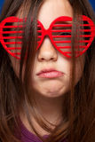 Girl with heart shaped sunglasses Stock Image