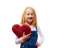 Girl with heart. Young girl with a red heart royalty free stock image