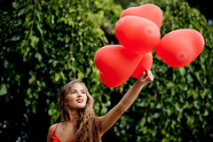 Girl with hearts Royalty Free Stock Images