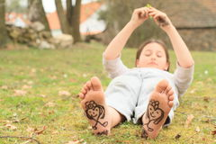 Girl with hearts on soles. Barefoot kid - funny girl with drawen hearts on on soles of her bare feet Stock Image