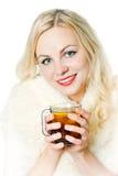 The girl  heated with hot tea Stock Photo