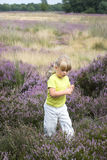 Girl in heather field 3 Royalty Free Stock Photos