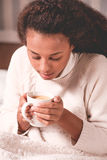 Girl heating cold hands. Image of girl with cup of tea heating cold hands Royalty Free Stock Photography
