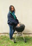 Girl heating herself Stock Image