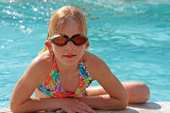 Girl is heaving fun in the pool Stock Photo