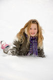 Girl is heaving fun in the snow Stock Image