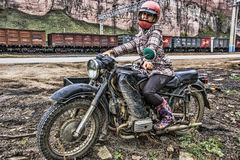 Girl on a heavy bike with a sidecar came for shopping, train sta. Minyar. Bashkir Republic. Of The Russian Federation. Dnepr-11 is a Soviet heavy motorcycle Stock Photo