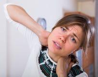 Girl heavy pain in neck Stock Photos