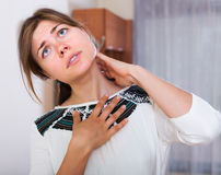 Girl heavy pain in neck Royalty Free Stock Image