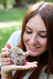 Girl and hedgehog royalty free stock images