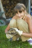 Girl with hedgehog Stock Photography
