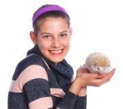 Girl with Hedgehog Stock Photo