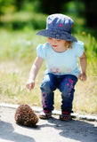 Girl and hedgehog Royalty Free Stock Photos