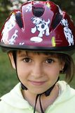 Girl in a Helmet. 7 years old girl in a cycling helmet Stock Images
