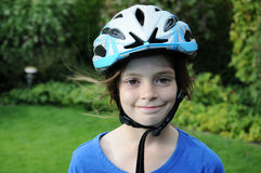 Girl with helmet. Girl with a bicycle protection helmet royalty free stock photography