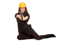 Girl in a helmet with a drill Royalty Free Stock Photo