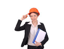 Girl in a helmet and a folder of documents in hand Stock Photos