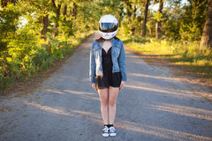 Girl in helmet with forest background Royalty Free Stock Image