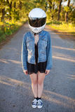 Girl in helmet with forest background Royalty Free Stock Photography