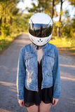 Girl in helmet with forest background Stock Image