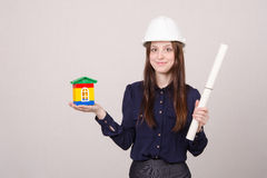 Girl helmet with house worth and drawing in hands Royalty Free Stock Photos