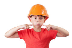 Girl in an helmet presses on the cheeks. Little girl in an orange helmet presses his fingers on the cheeks Royalty Free Stock Images