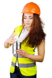 Girl in a helmet and vest looks into the open metal container. Stock Photo