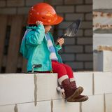 Girl with helmet working on construction Stock Image