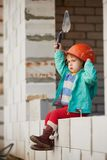 Girl with helmet working on construction Stock Photography