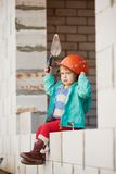 Girl with helmet working on construction Royalty Free Stock Images