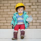 Girl with helmet working on construction Stock Photos