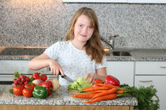 Girl help mom in the kitchen Stock Photo