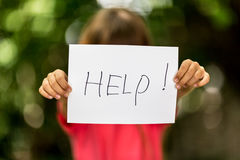 Girl with Help sign stock photo